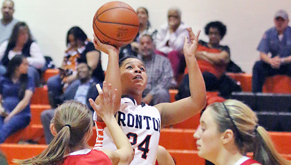 Ironton Lady Fighting Tigers' Alyssa Lewis (24) hits a jump shot from in the lane during an Ohio Valley Conference win over the Rock Hill Redwomen on Thursday. (Tim Gearhart of Tim's News & Novelties of Ironton)