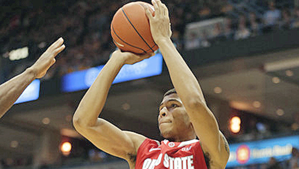 Ohio State Buckeyes' Marc Loving hits a jumper for two of his 13 points. Loving helped an early second half rally but fouled out as the Buckeyes lost to Louisville 64-55 on Tuesday. (MCT Direct Photo)