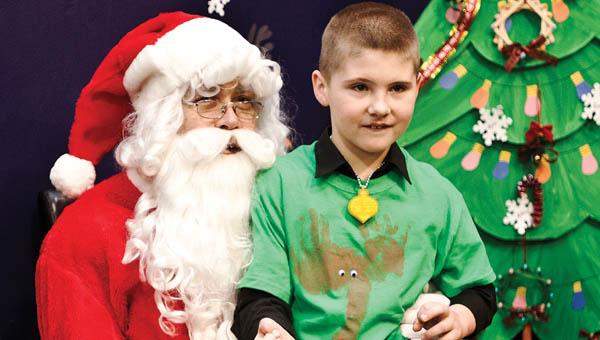 the tribune/jessica st. james A student from Open Door School meet with Santa Claus.