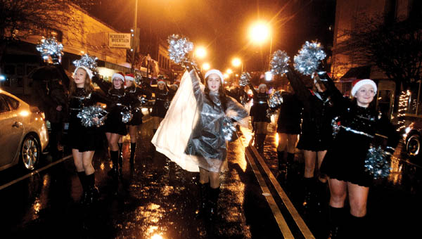 THE TRIBUNE/JESSICA ST JAMES (ABOVE) Members of the Ironton cheerleading team performed Monday during the annual Ironton Christmas Parade.