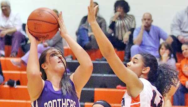 Ironton Lady Fighting Tigers' Cheyenne Scott (right) goes for the block as Chesapeake Lady Panthers' Kaylee Curry (14) goes up for a jumper during Monday's OVC game. Ironton won 32-28. (Photo Courtesy of Tim Gearhart of Tim's News & Novelties of Ironton)