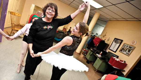 """THE TRIBUNE/JESSICA ST JAMES Yvonne DeKay dances with Rhiannon Stephens, the Sugar Plum Fairy, during rehearsal Wednesday evening for the upcoming production of """"Santa's Version of The Nutcracker."""""""
