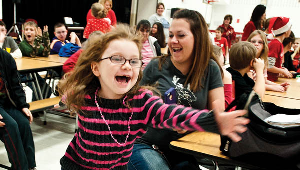 THE TRIBUNE/JESSICA ST JAMES Seven-year-old Shawna Cochran becomes excited as she runs up to meet Santa Claus.