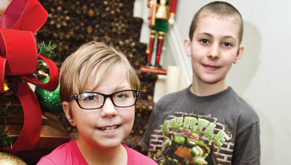 Nine-year-old Lakota Jones, left, and Zach Kearns, 10, right, are two of the three top places winners for the Lawrence County Historical Society's historical essay contest.