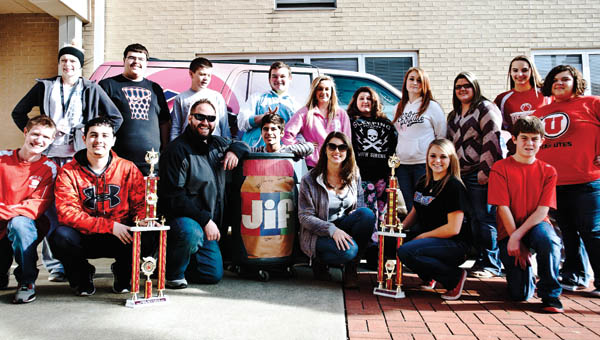 THE TRIBUNE/JESSICA ST JAMES WKEE morning show co-hosts Dave Roberts and Jen Seay with students from the Rock Hill Honor Society as they congratulate them on collecting the most jars of peanut butter as part of the peanut butter drive for 2014. Nearly 500 jars were collected this year.