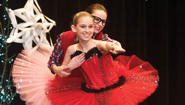 """Dancers from the Jeslyn Performing Arts Center perform musical number during """"A Musical Evening: Winter Extravaganza"""" at South Point High School.  THE TRIBUNE/JESSICA ST JAMES"""