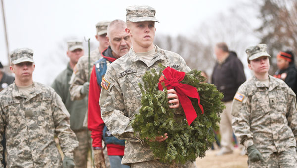 Members of the Ohio National Guard, out of Portsmouth, make their way to Lookout Point to place the final wreath during the ceremony.