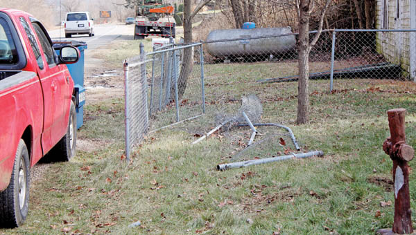 The Tribune/Dustin Melchior The damaged chain-link fence caused by the crash Saturday at the mobile home next to Bevins Auto Sales in Chesapeake.