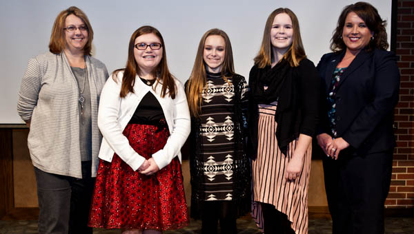 Pictured, from left, is OUS English professor Dr. Hayley Haugen, left, third-place winner Sarah Lemaster, first-place winner Olivia Goodenough, second-place winner Sydney Bane and OUS dean Dr. Nicole Pennington.