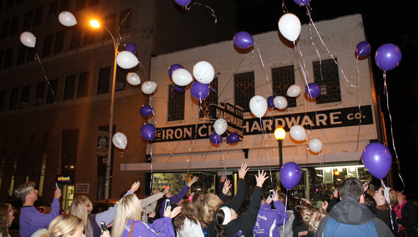 Dancers, parents and instructors launch balloons outside of Cyndi's Dance Studio on South Third Street on Monday to remember Rose Marie Rist.