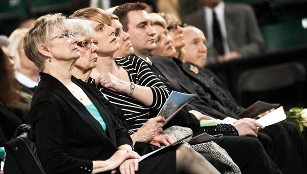 (ABOVE) The family of Dr. Stephen J. Kopp listens as one speakers tell amusing stories and speak fondly of the president during a memorial service on Tuesday. (BELOW) Justice Menis E. Ketchum II talks about his colleague and friend.