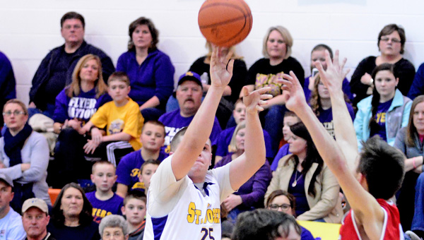 St. Joseph Flyers' senior Zack Kelly (25) hits a 3-point goal during a 58-40 win over the New Boston Tigers on Wednesday. Kelly had 11 points to lead the Flyers' offense. (Kent Sanborn of Southern Ohio Sports Photos)