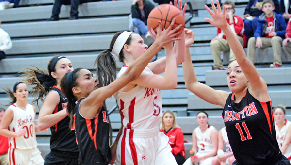 Ironton Lady Fighting Tigers' Zakia Lee (11) and Lexi Wise surround Rock Hill Redwomen's Taylor Hall as she tries to get off a shot during Thursday's OVC game. Ironton won the  game 62-22 on Thursday. (Kent Sanborn of Southern Ohio Sports Photos)