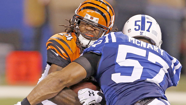 Cincinnati Bengals cornerback Adam Jones (24) is hammered by Indianapolis Colts outside linebacker Josh McNary (57) during second half action on Sunday. The Colts beat the Bengals 26-10 in the first round of the NFL playoffs. (MCT Direct Photos)