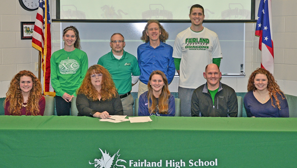 Fairland Lady Dragons' cross country runner Jessica Price signed a letter-of-intent on Monday to attend Shawnee State University. Attending the ceremony were: seated left to right, sister Julie, mother Sherri, Jessica, father Stuart and sister Jenny; standing from left to right, Fairland assistant coach Kira Dillon, Fairland head coach Chuck Wentz, Shawnee State head coach Eric Putnam, and Fairland assistant coach Adam Alt. (Kent Sanborn of Southern Ohio Sports Photos)