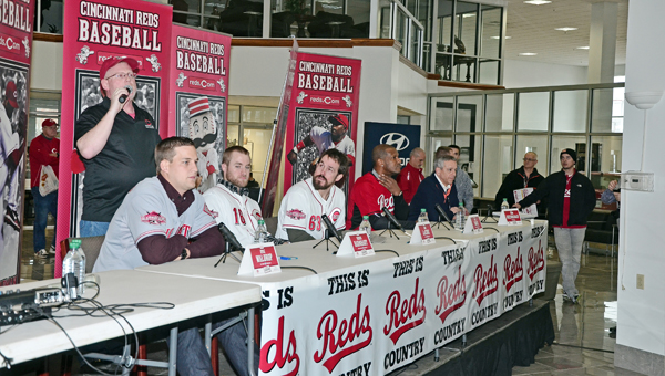 Members of the Cincinnati Reds who were part of the East Tour that appeared at Fannin Motors in Ashland, Ky., on Saturday included: from left to right, minor league outfielder Kyle Waldrop, catcher Tucker Barnhart, relief pitcher Sam LeCure, Reds' Hall of Fame outfielder Eric Davis and announcer Thom Brennaman. (Kent Sanborn of Southern Ohio Sports Photos)