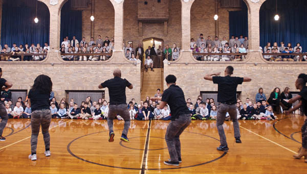 Members of the Step Afrika! dance troupe perform for students in the Ironton Catholic Schools on Thursday. Step Afrika! is the first professional company in the world dedicated to the traditional of stepping. A local performance will take place at 7:30 p.m. Saturday at the Paramount Arts Center.