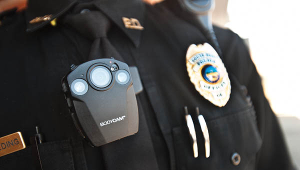 THE TRIBUNE/JESSICA ST JAMES Members of the South Point Police Department now wear clip-on body cameras while on duty. The cameras are compact and are remote controlled.