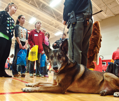 Hemi, the Lawrence County Sheriff's Office drug dog, takes a breather while his master, Deputy Steve Wilson, talks about law enforcement.