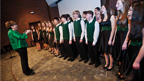 """Members of the Fairland High School Varsity Vocals perform the national anthem and """"Let There Be Peace on Earth."""""""