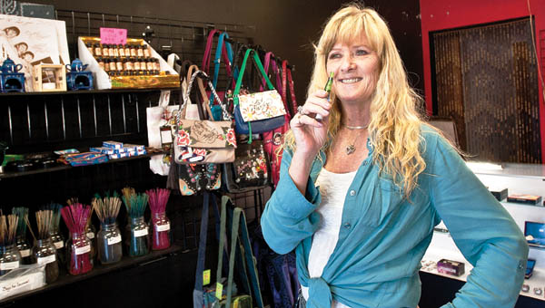 THE TRIBUNE/JESSICA ST JAMES Penny Nichols is owner of Mystic Treasurers LLC on Marion Pike in Coal Grove. The shop features incense, e-cigarettes, jewelry, purses and more.