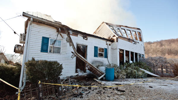 The structure barely stands following two fires in the four days at Sky Lake in Windsor Township. Fire departments from Chesapeake, Proctorville and Rome townships helped battle the early morning blaze.