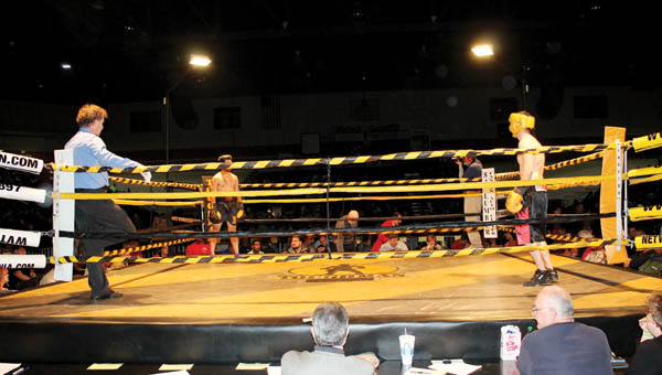 The Tribune/Dustin Melchior Two competitors get ready to fight Friday at the Toughman Contest.