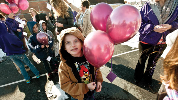 James Hall waits anxiously for the annual balloon launch at Open Door School.