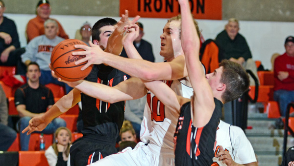 Ironton Fighting Tigers' Joe Bowling drives for a layup while being fouled by two Wheelersburg defenders. Ironton beat Wheelersburg 59-49 on Tuesday. (Kent Sanborn of Southern Ohio Sports Photos)