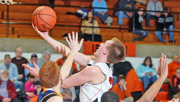 Ironton Fighting Tigers' senior Tristan Cox drives through the South Point defense for a layup during Friday's game. Ironton beat the Pointers 72-38. (Kent Sanborn of Southern Ohio Sports Photos)