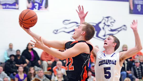 Ironton Fighting Tigers' Tristan Cox (22) drives to the basket as Chesapeake Panthers' Kolton Webb (5) attempts to block the shot during Friday's OVC game. The Panthers won 65-55. (Kent Sanborn of Southern Ohio Sports Photos.com)