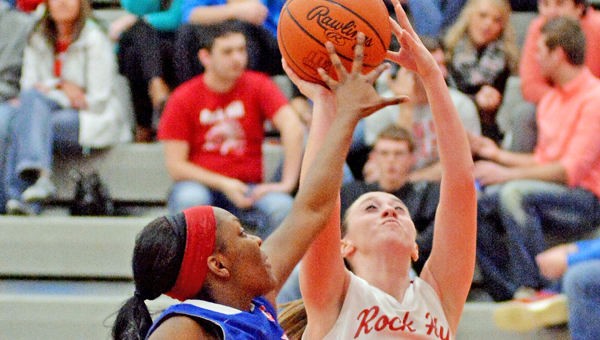 Rock Hill Redwomen guard Madison Damron (2) scores against a Portsmouth defender during Thursday's game. Damron had 11 points as Rock Hill won 62-54 on Senior Night. (Robert S. Stevens & The Gold Studio of Ironton)