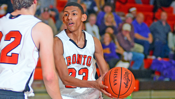 Ironton Fighting Tigers' junior guard Marques Davis scored 14 points including three key 3-point goals in a 75-68 win over the upset-minded Wellston Golden Rockets on Monday in the Division III sectional tournament at Jackson. (Kent Sanborn of Southern Ohio Sports Photos)