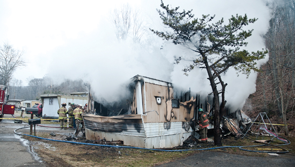 Firefighters from South Point and Fayette and Perry townships put out a fire Wednesday on Gary Malone Street in South Point.