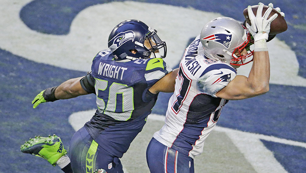 New England Patriots' Rob Gronkowski catches a touchdown pass over Seattle Seahawks' K.J. Wright in the first half of Superbowl XLIX on Sunday at the University of Phoenix Stadium in Glendale, Ariz. The Patriots won 28-24. (MCT Direct Photo)