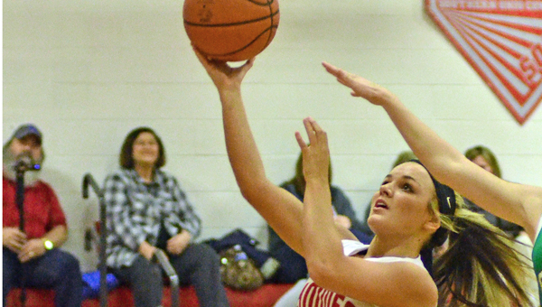 Symmes Valley Lady Vikings' Meranda Hayes (13) scored 20 points on Tuesday in the Division IV sectional tournament. The Lady Vikings beat South Gallia 43-29. (Robert S. Stevens & The Gold Studio of Ironton)