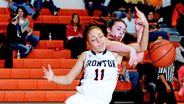 Ironton Lady Fighting TIgers' Zakia Lee (11) goes for a rebound but is fouled by Lewis County's Allison Voyles during Saturday's game. Ironton beat the Lady Lions 57-47. (Kent Sanborn of Southern Ohio Sports Photos)