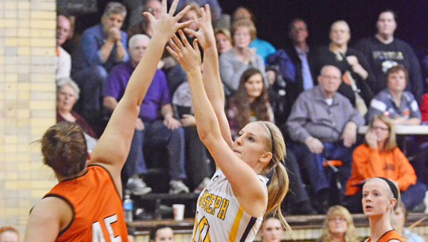 St. Joseph Female Flyers' senior Amber Neal (10) puts up a shot and scores the 1,000th point of her career in a 73-58 win over the Raceland Lady Rams on Monday. (Kent Sanborn of Southern Ohio Sports Photos)