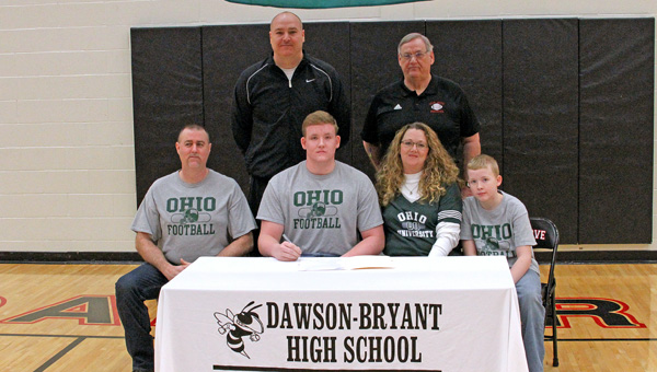 Coal Grove Hornets' senior lineman Austen Pleasants signed a national letter of intent Wednesday with the Ohio Bobcats. Attending the ceremony were: seated from left to right, father Michael Wilburn, Austen, mother Jennifer Pleasants and brother Arik; standing from left to right, Coal Grove assistant coach Jay Lucas and head coach Dave Lucas. (Kent Sanborn of Southern Ohio Sports Photos)