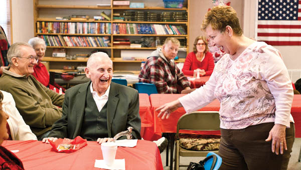 Coordinator Darlene Green laughs with Ray Eplin as they and others share their Valentine's Day stories during a party at the new Chesapeake Senior Center, located alongside the Chesapeake Community Center, Friday.