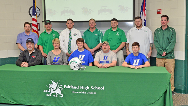 Fairland Dragons' senior quarterback Chance Short signed a letter-of-intent Thursday to play football for Urbana University. Attending the ceremony were: seated from left to right, uncle Buster Trimble, mother Wendy, Chance, father Paul and brother Gunner; standing from left to right, football coaches Dave Carroll, Chad Graham, Jeff Gorby (athletic director), Layne Wireman, Mike Jackson, Josh Ward and Fairland head basketball coach Nathan Speed. (Kent Sanborn of Southern Ohio Sports Photos)