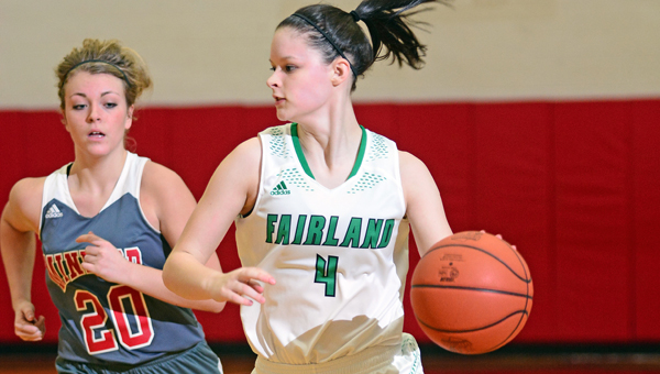 Fairland Lady Dragons' senior point guard Taylor Staten (4) brings the ball up the court against Minford in Sunday's Division III sectional tournament game. Fairland won 51-39. (Kent Sanborn of Southern Ohio Sports Photos)