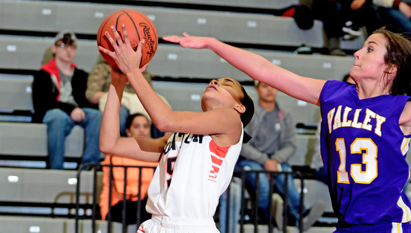 Ironton Lady Fighting Tigers' Lexi Wise (5) makes a layup during a 63-29 rout of the Lucasville Valley Lady Indians on Sunday in the Division III sectional finals. (Kent Sanborn of Southern Ohio Sports Photos)