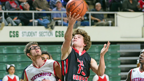 Coal Grove Hornets' Brandon Adkins (15) hits a reverse layup during Sunday's Division III district semifinal game against Portsmouth at Ohio University. The Hornets fell 60-46. (Kent Sanborn of Southern Ohio Sports Photos)