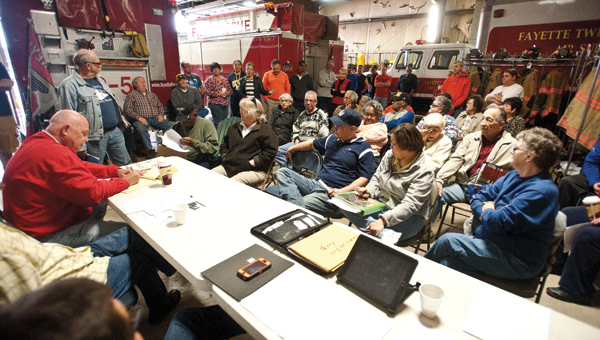 Many members of the Concerned Citizens of Burlington gathered inside the local fire station to addresses issues over the Commons park during the Fayette Township Trustees meeting on Monday.