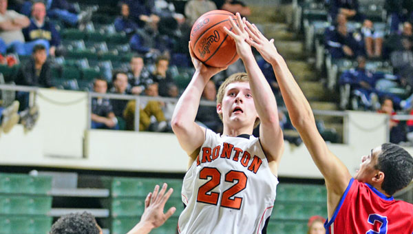 Ironton Fighting Tigers' senior guard Tristan Cox (22) hits a jumper for two of his 20 points in a 72-51 loss to Portsmouth on Wednesday in the Division III regional semifinals at Ohio University. (Kent Sanborn of Southern Ohio Sports Photos)