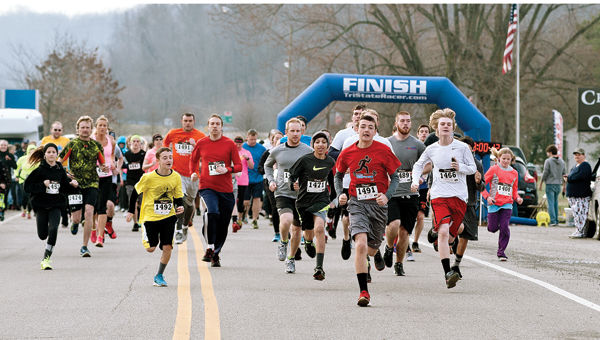 At the starting line, 5K participants take off Saturday morning during the Lawrence County Board of Developmental Disabilities 5K run/walk for awareness.
