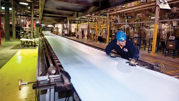 An employee with Dow Chemical smooths out Styrofoam at the Hanging Rock production site.
