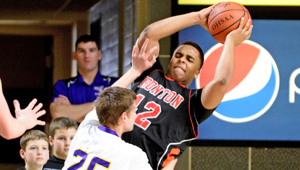 Ironton Fighting Tigers' center Desmond Young (42) grabs one of his 11 rebounds while avoiding Lucasville Valley's Aaron Linne (25) Ironton upset Valley 48-39 Sunday to reach the Division III district finals at 6 p.m. on Saturday. (Kent Sanborn of Southern Ohio Sports Photos)