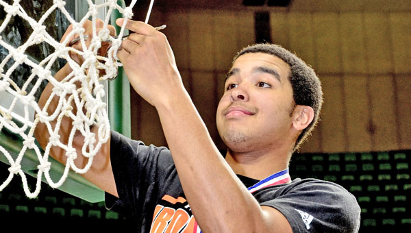 Ironton senior guard Johnny Johnson cuts down a piece of the net after the Fighting Tigers won the Division III district title. (Kent Sanborn of Southern Ohio Sports Photos)